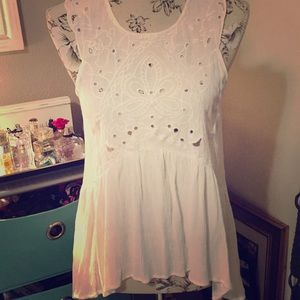 White tank with eyelet detail and flowey bottom